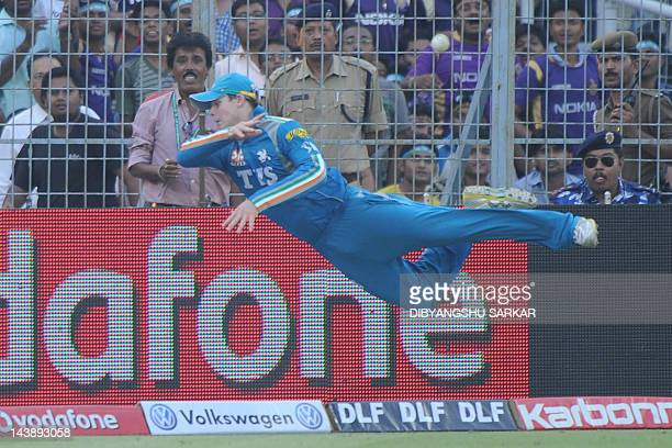 Pune Warriors India fielder Steve Smith attempts a catch at the boundary line during the IPL Twenty20 cricket match between Kolkata Knight Riders and...