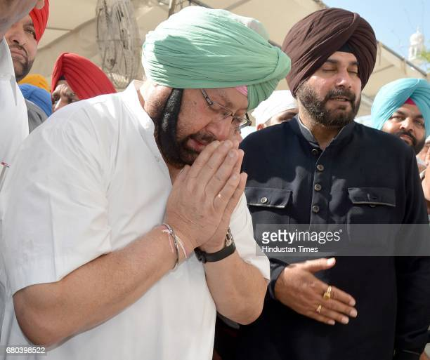 Punjab Chief Minister Captain Amarinder Singh along with Amritsareast legislator Navjot Singh Sidhu and others paying obeisance at Golden Temple on...