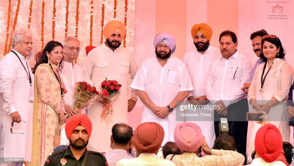Punjab Chief Minister Captain Amarinder Singh (C) with Punjab Local Bodies Minister Navjot Singh Sidhu (4L), Notable Indian Poet, Writer, Lyricist and Film Director Gulzar (3L), MP Gurjit Singh Aujla (3R), MLA OP Soni (3R) and CEO of Partition Museum Keshwar Singh (R) during the inauguration of Partition Museum at Town Hall, on August 17, 2017 in Amritsar, India.