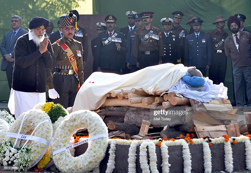 Punjab Chief Minister Parkash Singh Badal pays his respect during the cremation of former Prime Minister IK Gujral at Smriti Sthal in New Delhi on Saturday.