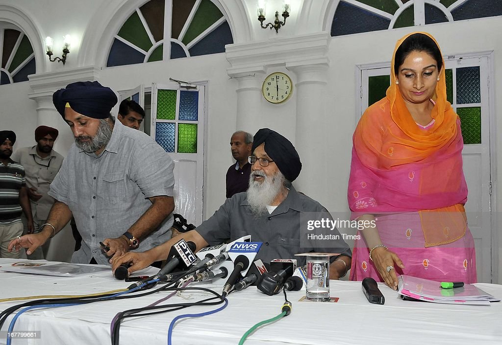 "Punjab CM Parkash Singh Badal (C) with Sukhbir Singh Badal (Deputy Chief Minister of Punjab) (L) and Harsimrat Kaur Badal (R) briefing media about wealth tax that is being levied on agricultural land, ""Which can be a serious conflagration of social disorder, anarchy and economic crisis in the country"" and acquittal of Sajjan Kumar in the 1984 riots case during a press conference at the Kaputhala House on April 30, 2013 in New Delhi, India."