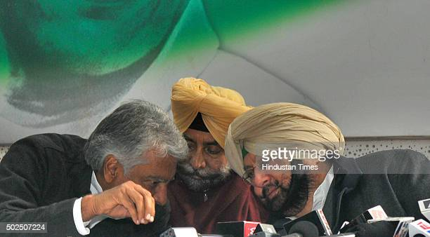 Punjab Congress President Capt Amrinder Singh in discussion with Congress leaders Jagmeet Brar and Sunil Jakhar during the press conference at Punjab...