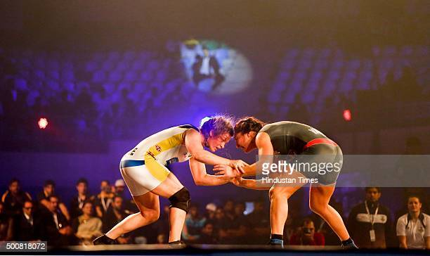 Punjab female wrestler Vasilisa Marzaliuk fights a bout against Mumbai's Adeline Gray during a Pro Wrestling League at Indra Gandhi Stadium on...