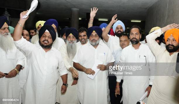Punjab former Deputy CM Sukhbir Singh Badal along with Akali senior leaders protesting outside Punjab Vidhan Sabha Session on June 14 2017 in...