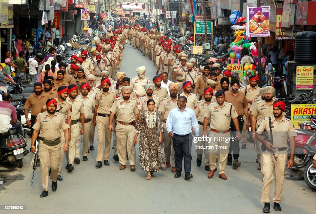 Punjab Police along with jawans of CRPF take out flag march to keep the law and order situation under control in the district as members of Dera Sacha Sauda in large number arrive for the support of Dera Chief Sant Gurmeet Ram Rahim Singh as the hearing of Sadhavi rape and murder case will be on August 25, on August 23, 2017 in Bathinda, India.