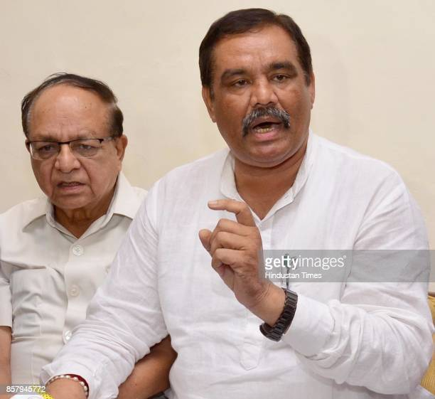 Punjab President and Union minister of state for social justice and empowerment Vijay Sampla with Former mayor Bakshi Ram Arora addressing a press...