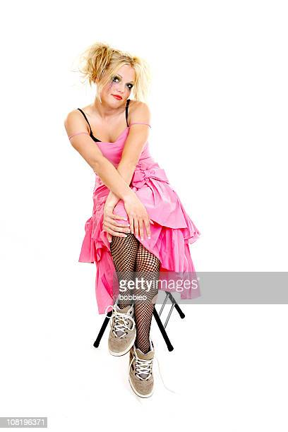 Punk Dressed Woman in Prom Dress Sitting on Chair