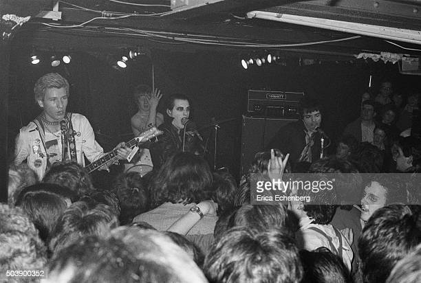Punk fans in the audience at the Roxy club crowd up to the stage as English punk rock band The Damned perform Covent Garden London 1977 LR Captain...