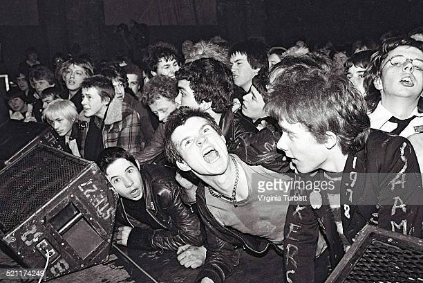 Punk fans shout and jostle in the audience at the front of the stage while the Ruts perform at a Rock Against Racism concert Alexandra Palace London...