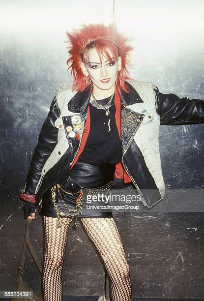 Punk Girl in skirt and fish net tights a £1 Punk Chelsea London 1984