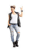 Full length portrait of a punk girl making a rock hand gesture isolated on white background