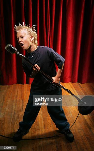 Punk Kid on Stage Singing into a Microphone