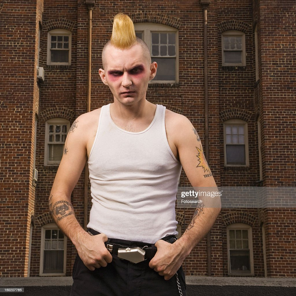 Punk outside with building in background