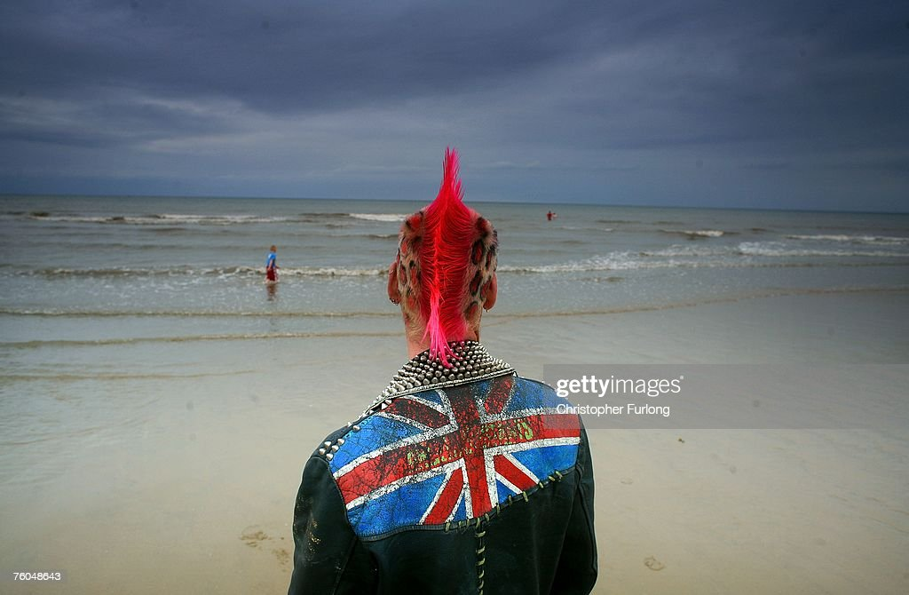 Punk rocker Jacquesy from Manchester looks out to the Irish Sea on Blackpool beach before the start of the Rebellion Festival on August 10 Blackpool...