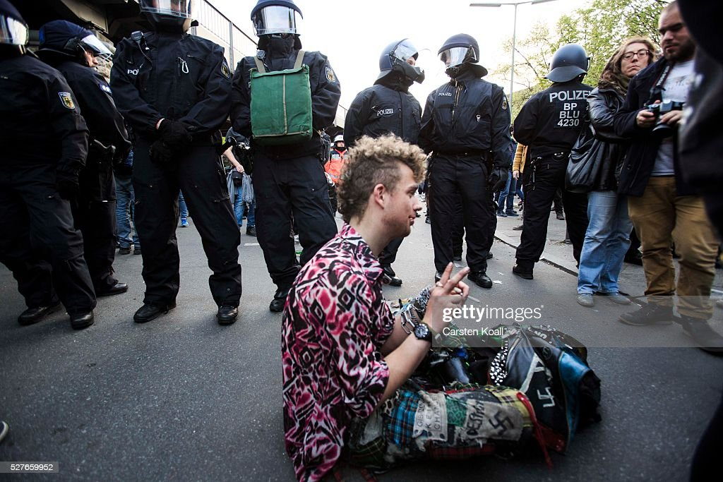 A punk sits in front of a line of German riot police after leftist protesters march on May Day on May, 2016 in Berlin, Germany. Tens of thousands of people across Germany participated in marches and gatherings by labor unions and in some cities left-wing and anarchist activists took to the streets under heavy oversight by police. In Berlin far-right protesters also attempted to hold rallies during the day.