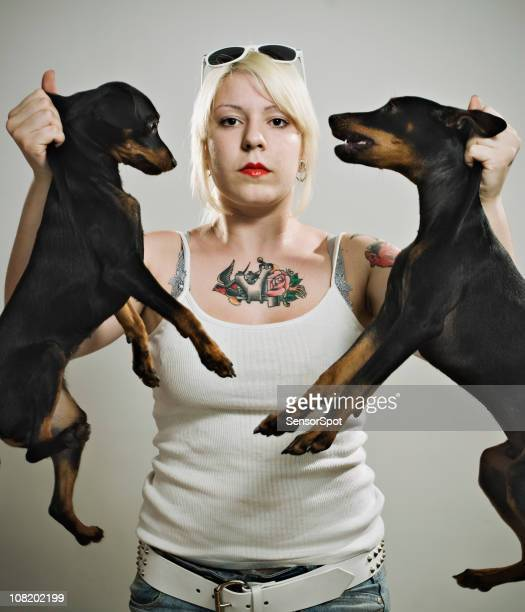 Punk Woman Carrying Two Dogs