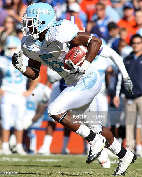 Punt returner Andre Roberts of the Citadel Bulldogs returns a punt against the Florida Gators during the game at Ben Hill Griffin Stadium on November...