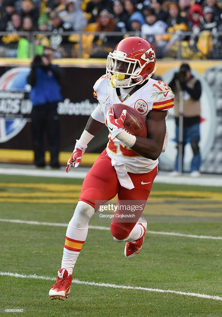 Punt returner <a gi-track='captionPersonalityLinkClicked' href=/galleries/search?phrase=De%27Anthony+Thomas&family=editorial&specificpeople=8222432 ng-click='$event.stopPropagation()'>De'Anthony Thomas</a> #13 of the Kansas City Chiefs runs with the football during a game against the Pittsburgh Steelers at Heinz Field on December 21, 2014 in Pittsburgh, Pennsylvania. The Steelers defeated the Chiefs 20-12.