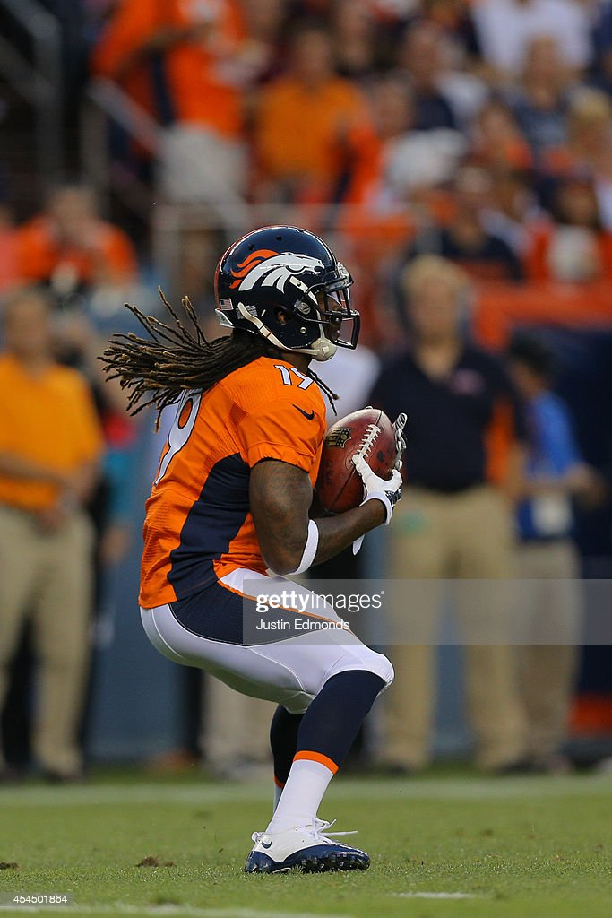 Punt returner <a gi-track='captionPersonalityLinkClicked' href=/galleries/search?phrase=Isaiah+Burse&family=editorial&specificpeople=7228109 ng-click='$event.stopPropagation()'>Isaiah Burse</a> #19 of the Denver Broncos during a preseason game against the Houston Texans at Sports Authority Field at Mile High on August 23, 2014 in Denver, Colorado.