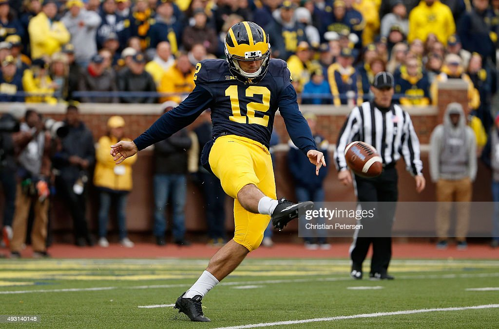 Punter Blake O'Neill of the Michigan Wolverines punts the ball during the first quarter of the college football game against the Michigan State...