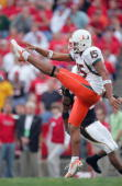 Punter Brian Monroe of the Miami Hurricanes punts the ball during the game against the Maryland Terrapins at Byrd Stadium November 11 2006 in College...
