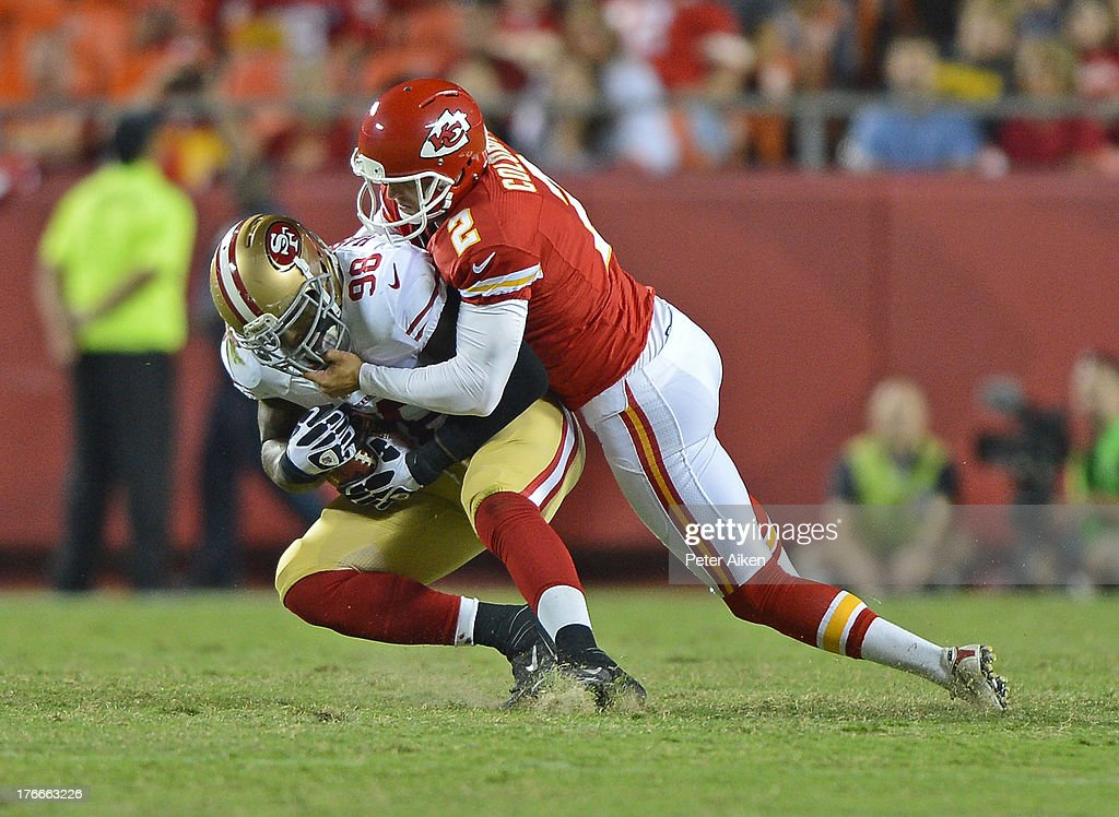 Punter Dustin Colquitt #2 of the Kansas City Chiefs tackles linebacker <a gi-track='captionPersonalityLinkClicked' href=/galleries/search?phrase=Parys+Haralson&family=editorial&specificpeople=592594 ng-click='$event.stopPropagation()'>Parys Haralson</a> #98 of the San Francisco 49ers, after Haralson blocked Colquitt's punt during the second half on August 16, 2013 at Arrowhead Stadium in Kansas City, Missouri. The 49ers won 15-13.