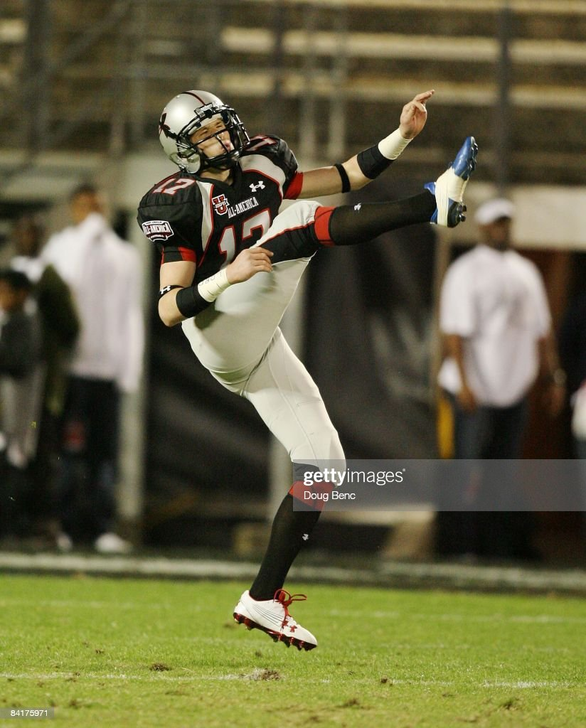 Punter Dustin Hopkins of the black team follows through on a punt in the All America Under Armour Football Game at Florida Citrus Bowl on January 4...