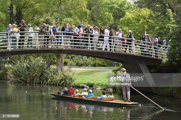 A punter greets people who release flowers into the Avon River as remembrance following a Civic Memorial Service held in the Botanical Gardens for...