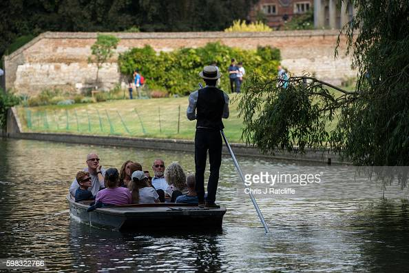 A punter in traditional dress takes tourists down the River Cam on September 1 2016 in Cambridge England Punting is popular with many tourists in...