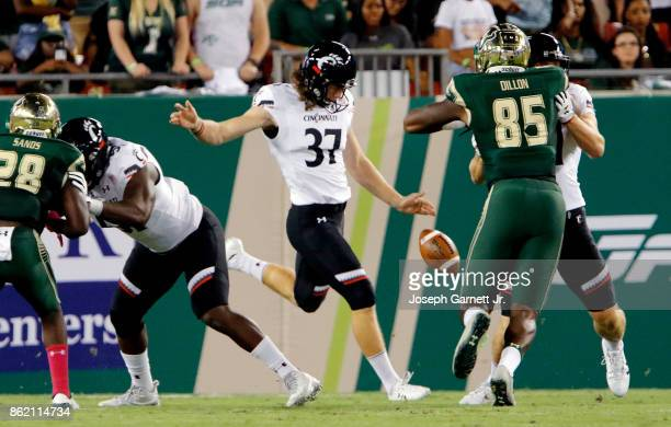 Punter James Smith of the Cincinnati Bearcats punts the ball to the South Florida Bulls during the first quarter of their game at Raymond James...