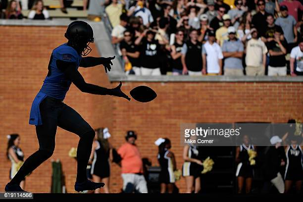 Punter JD Mote of the Army Black Knights makes punts against the Wake Forest Demon Deacons at BBT Field on October 29 2016 in Winston Salem North...