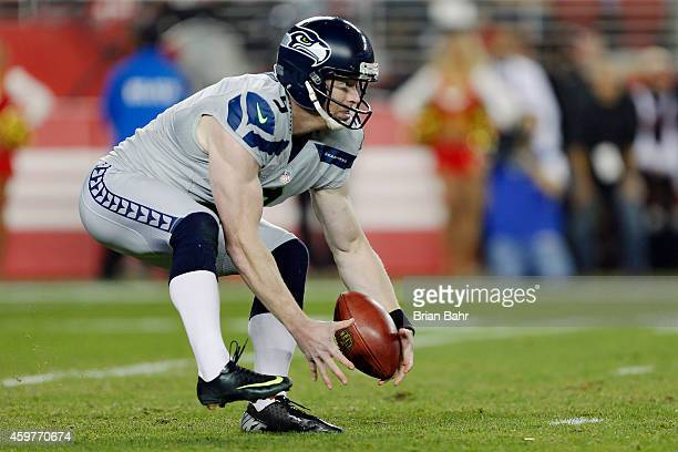 Punter Jon Ryan of the Seattle Seahawks bobbles a low snap before recovering to kick for 45 yards followed by a turnover on the return by the San...