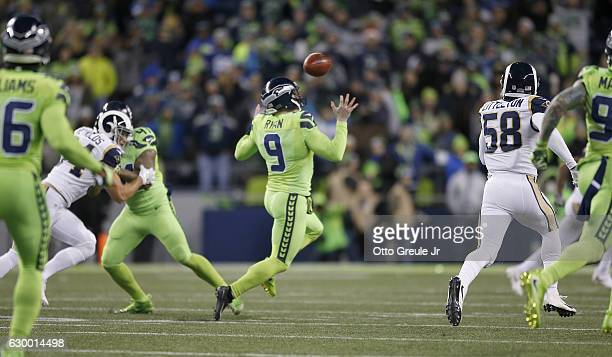 Punter Jon Ryan of the Seattle Seahawks bobbles the ball on a run against the Los Angeles Rams at CenturyLink Field on December 15 2016 in Seattle...