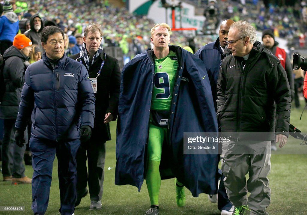 Punter Jon Ryan #9 of the Seattle Seahawks leaves the game after getting injured on a play against the Los Angeles Rams at CenturyLink Field on December 15, 2016 in Seattle, Washington.