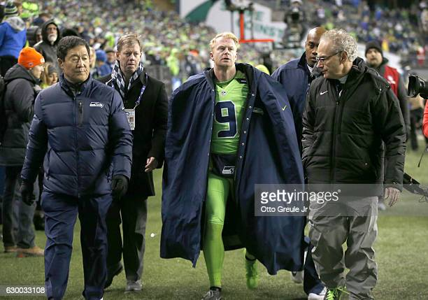 Punter Jon Ryan of the Seattle Seahawks leaves the game after getting injured on a play against the Los Angeles Rams at CenturyLink Field on December...