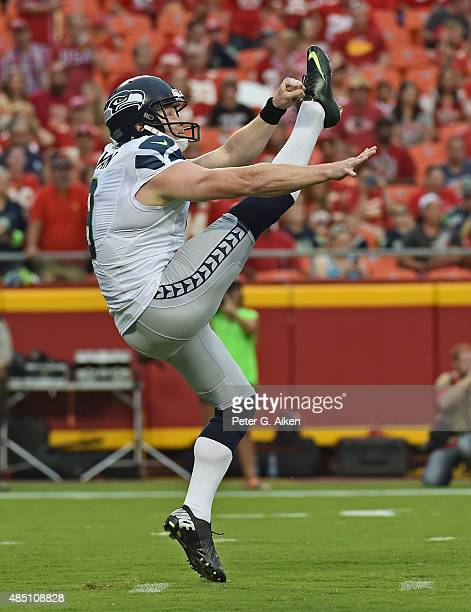 Punter Jon Ryan of the Seattle Seahawks punts the ball down field against the Kansas City Chiefs during the first half of a preseason game at...