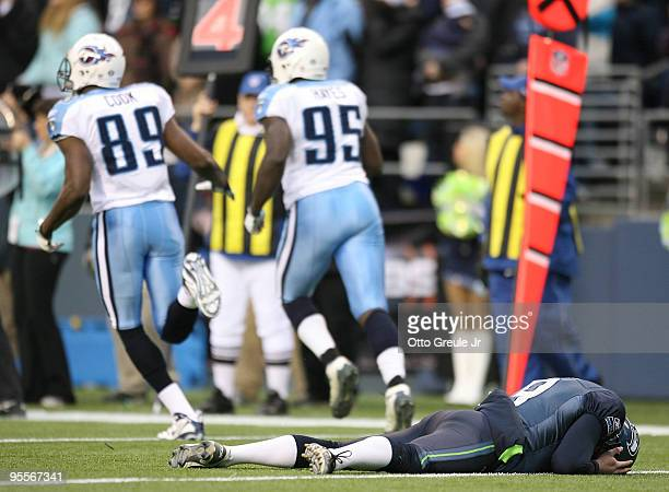 Punter Jon Ryan of the Seattle Seahawks remains on the ground after kicking a 19 punt in the fourth quarter against the Tennessee Titans on January 3...
