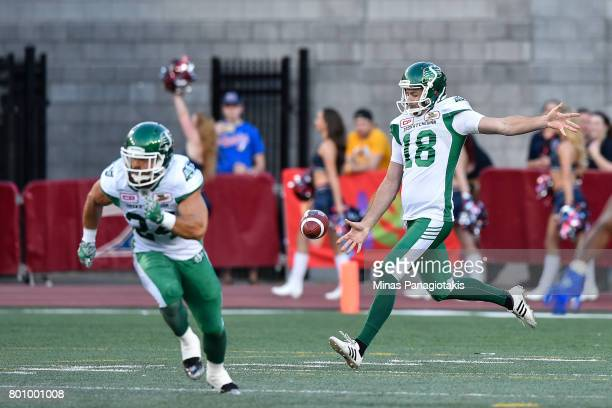 Punter Josh Bartel of the Saskatchewan Roughriders prepares to kick the ball against the Montreal Alouettes during the CFL game at Percival Molson...