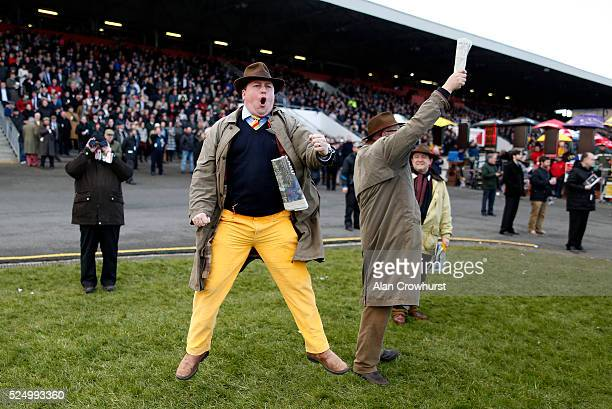 A punter jumps for joy as he watches Irish Cavalier win The Guinness Handicap Steeplechase at Punchestown racecourse on April 27 2016 in Naas Ireland
