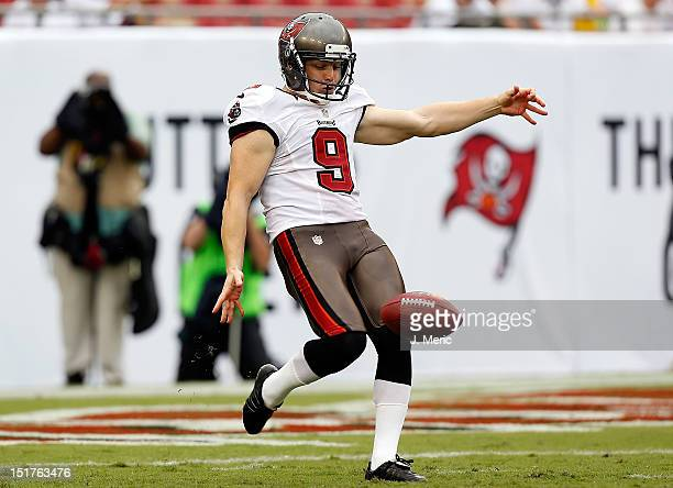 Punter Michael Koenen of the Tampa Bay Buccaneers punts against the Carolina Panthers during the season opening NFL game at Raymond James Stadium on...