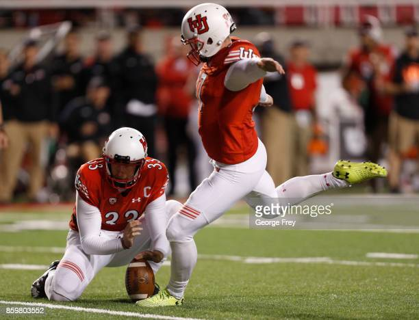 Punter Mitch Wishnowsky of the Utah Utes hold the ball for kicker place kicker Matt Gay during the second half of an college football game against...