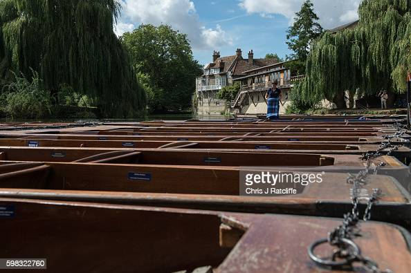 A punter puts blankets in punt boats on the River Cam on September 1 2016 in Cambridge England Punting is popular with many tourists in Cambridge as...