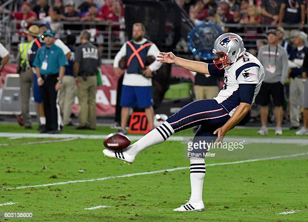 Punter Ryan Allen of the New England Patriots punts the ball to the Arizona Cardinals during the NFL game at University of Phoenix Stadium on...