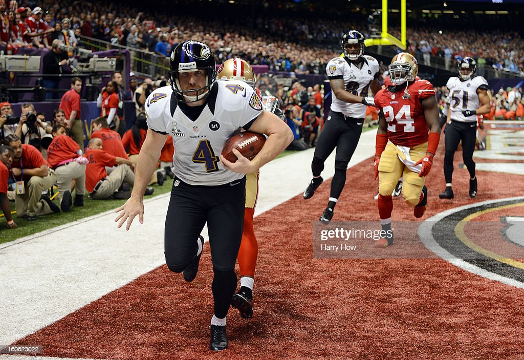 Punter <a gi-track='captionPersonalityLinkClicked' href=/galleries/search?phrase=Sam+Koch&family=editorial&specificpeople=2106602 ng-click='$event.stopPropagation()'>Sam Koch</a> #4 of the Baltimore Ravens holds the ball in the endzone as he takes a safety in the final minute of the fourth quarter against the San Francisco 49ers during Super Bowl XLVII at the Mercedes-Benz Superdome on February 3, 2013 in New Orleans, Louisiana.
