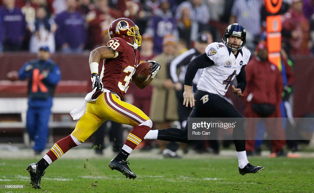 Punter Sam Koch #4 of the Baltimore Ravens moves in to tackle Richard Crawford #39 of the Washington Redskins on a punt return in overtime of the Redskins 31-28 win at FedExField on December 9, 2012 in Landover, Maryland.