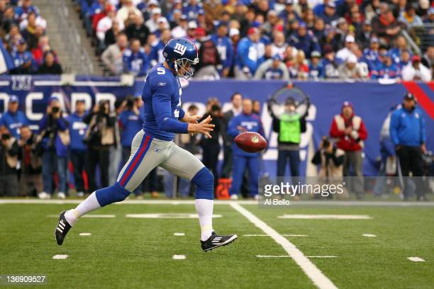 Punter Steve Weatherford of the New York Giants punts the ball against the Atlanta Falcons during their NFC Wild Card Playoff game at MetLife Stadium...