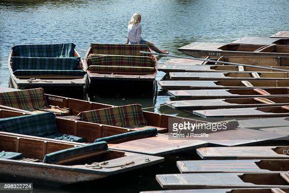 A punter takes a break and dips her feet in the water on the River Cam on September 1 2016 in Cambridge England Punting is popular with many tourists...