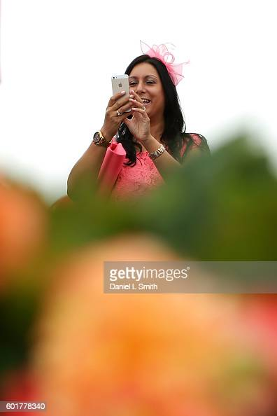 A punter takes a photograph on her mobile phone ahead of the Doncaster Races at Doncaster Racecourse on September 10 2016 in Doncaster England
