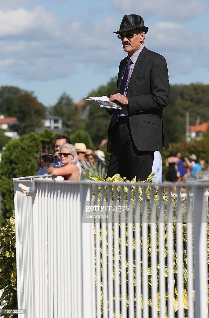 A punter watches the horses enter the track during the Karaka Million at Ellerslie Racecourse on January 27, 2013 in Auckland, New Zealand.