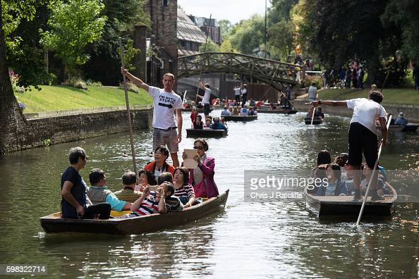 A punter wearing a 'I'm with stupid' tshirt takes tourist down the River Cam on September 1 2016 in Cambridge England Punting is popular with many...